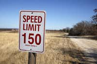 A sign on the drive into Oak Creek Vineyards reminds Howard Davies and Amy Sterling to mind the speed limit.