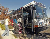 Passengers board the Metro ArlingtonXpress near the University of Texas at Arlington's College Park Center.