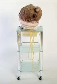 "Bonny Leibowitz Assisted Living 2013 52 x 17 x 15""   burl wood, plaster,  acrylic, petrified wood, medical cart and tubing"