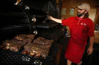 Stiles Switch BBQ & Brew pitmaster Lance Kirkpatrick smokes beef ribs the way he learned from famed pitmaster Bobby Mueller during the Posse's final stop on the Austin BBQ Tour.
