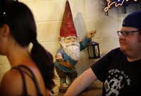 Franklin Barbecue's gnome that once stood outside the original trailer along I-35 greets patrons at the counter.