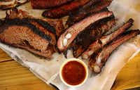 A tray full of brisket, ribs and sausage at John Mueller Meat Co.