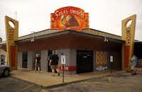 Members of the Texas BBQ Posse enter Stiles Switch BBQ & Brew on N. Lamar in Austin.