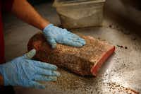 Stiles Switch BBQ & Brew pitmaster Lance Kirkpatrick preps whole briskets the way he learned from famed pitmaster Bobby Mueller at Louie Mueller's in Taylor.
