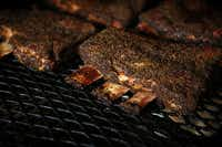 Beef ribs on the smoker at Stiles Switch BBQ & Brew.