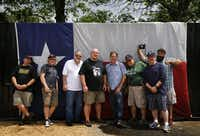 The Texas BBQ Posse poses for a photo at John Mueller Meat Co. during the Austin BBQ Tour. Left to right, R.J. Hinkle, Bryan Gooding, Gary Jacobson, Jim Rossman, Tom Fox, Chris Wilkins, Bruce Tomaso and Daniel Goncalves.