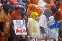 It was hard to keep signs  or anything else dry at the University of Texas game against Kansas State in Austin. The reward for water-logged fans was a Longhorn victory, but a flash flood watch was to remain in effect through Sunday morning.(Michael Thomas - The Associated Press)