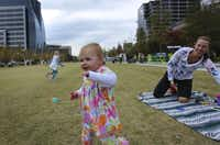 Kate Hanratty (right), and her 15-month-old daughter, Kendall, relaxed in Klyde Warren Park on Monday while waiting for friends.
