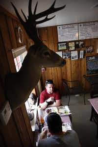 Diners eat lunch at Virgie's Bar-B-Que on Gessner Dr. in Houston, Texas Friday, June 27, 2014.( Tom Fox  -  Staff Photographer )
