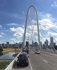 Sheriff's deputies lined the Margaret Hunt Hill Bridge west of downtown Dallas in honor of slain Deputy Darren Goforth. (David Woo/Staff Photographer)