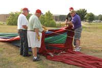 Cannon instructs (from left) John McGill, Tony Casteel and Pat Davis on their roles in getting the balloon up at the recent media preview for the Highland Village Balloon Festival 2014, which will take place this weekend.Adam Schrader - neighborsgo
