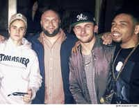 Johnny Manziel (center right) attended a Justin Bieber concert hours after a grand jury indicted the 2012 Heisman Trophy winner. Bieber (left) and Manziel posed for a photo with Cleveland Browns cornerback Joe Haden (right).