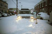 A Land Rover is stuck in a snow drift as snow continues to fall on January 23, 2016 in Philadelphia, Pennsylvania. (Photo by Jessica Kourkounis/Getty Images)