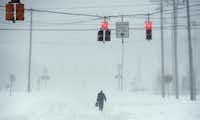 A lone figure walks along Memory Lane in Springettsbury Township, Pa., during Saturday's snowstorm on Jan. 23, 2016. (Jason Plotkin/York Daily Record via AP)