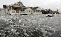 Water and ice floods 12th Ave in North Wildwood, N.J., at the height the storm on Saturday, Jan. 23, 2016. (Dale Gerhard/Press of Atlantic City via AP)