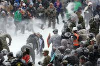 The battle lines were drawn with Hokies on the left and Cadets on the right during an annual Civilians vs. Corps of Cadets snowball fight on the Virginia Tech campus in Blacksburg Va. Saturday Jan. 23 2016. (Matt Gentry/The Roanoke Times via AP)