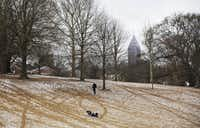 Children try to sled down a hill dusted in snow in Piedmont Park Saturday, Jan. 23, 2016, in Atlanta. Metro Atlanta experienced some snowfall Saturday morning but nothing more than an inch from a blizzard that brought much of the East Coast to a standstill. (AP Photo/David Goldman)