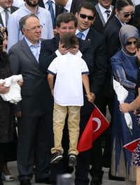 Turkeys Prime minister Ahmet Davutoglu (C) kisses a boy of a hostage as he welcomes on September 20, 2014 in Ankara dozens of freed Turkish nationals hostages held by Islamist militants in northern Iraq for more than three months. Fighters from the Islamic State (IS) kidnapped 49 Turks including diplomats, children and special forces from the Turkish consulate in Mosul on June 11 as they captured swathes of northern Iraq. ADEM ALTAN/AFP/Getty Images)