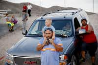 Rick Abbasi, of Tonopah, Nevada, holds onto his son, Carson Abbasi, 1 year old, while watching a high school football game between Sierra Lutheran and Tonopah in Tonopah Friday August 28, 2015. Tonopah beat the team from Carson City, Nevada 55-26. (Andy Jacobsohn/The Dallas Morning News)