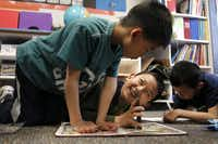 Third-graders (from left) Jason Huang, Alex Cheong and Ray Chu solve problems together in a gifted-and-talented class at Borchardt Elementary.(Lara Solt - Staff Photographer)