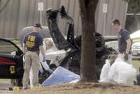 Authorities worked at the scene Monday, a day after the shootout outside the Curtis Culwell Center. Police cautioned that the investigation will probably be a long one.( Ron Baselice  -  Staff Photographer )