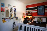 Bold stripes anchor one wall of Jackson's room. Another is used like a bulletin board.