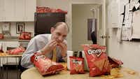 """Eric Haviv of Atlanta spent $1,700 on """"Breakroom Ostrich."""" He's one of five finalists in Doritos' """"Crash the Super Bowl"""" contest vying for a $1 million grand prize."""