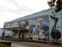 "The ""Birthplace of Country Music Mural"" in Bristol, TN, commemorates several music legends who made recordings for the 1927 Bristol Sessions, which Johnny Cash called the single most important event in the history of country music. The mural decorates Bristol's Downtown Center, site of farmers markets and concerts."