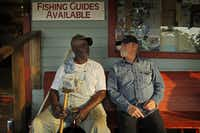 Longtime fishing guide Henry Lewis (left) chats with Eagles musician Don Henley outside a bait and tackle shop in Uncertain, Texas. Henley, a Gilmer native, created the Caddo Lake Institute to safeguard the lake's ecology and cultural identity.