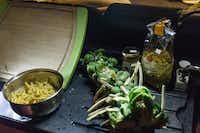 A meal of pasta  and Brussels sprouts was prepared from the back of the Jucy Champ.(Jason Henry - For The Washington Post)