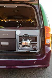A kettle of water  warms up over the van's propane burner.(Jason Henry - For The Washington Post)