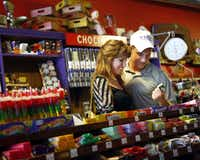 Denton teens Kara Kelsey, 17 (left) and Tyler Eveleth, 18, look at funny and cute candy labels at Atomic Candy in Denton. Here, you can find gum balls and Jelly Belly gourmet jelly beans in a multitude of flavors, a wide assortment of bulk candy and soda pop, and lots of novelty items.