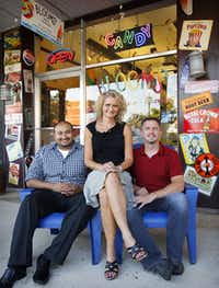 Blooms Candy and Soda Pop Shop co-owners from left, Sid Iraheta, Nicole Winn, and John Meadows pose in front of their shop at 1104 W. Main Street in downtown Carrolton.