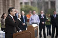 State senator Carlos Uresti spoke at a rally held outside on the steps of the State Capitol for protesters against the budget cuts for nursing homes and in-home care stand outside the State capitol steps in Austin.