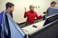 TCU junior and 13-year old prodigy Carson Huey-You (center) can't figure out a computer issue with classmate Jacob Evans (left) during a study period in the Tucker Technology Building at TCU. (Tom Fox/The Dallas Morning News)