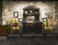 """Midway through the Johnny Cash Museum visitors see an antique sideboard, crystal and other things taken from Cash's former lakeside home in Hendersonville, Tenn., including a limestone wall from the room where Cash filmed scenes for 2003s video of """"Hurt."""""""