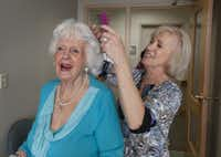 Janie Hill gets a comb-out from Linda Beasley at C.C. Young.