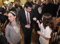 John Ratcliffe gave a fist bump Tuesday night to 11-year-old daughter Darby at the campaign's headquarters in his home in Heath.( Jason Janik  -  Special Contributor )