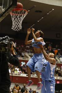 Michelle Williams of Destiny's Child got a boost from the Dallas Mavericks' Shawn Marion during MegaFest's Ball Up celebrity basketball game at the Kay Bailey Hutchison Convention Center in Dallas.