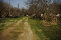 A back alley in Kemp. Texas as a place of farms and ranches and small towns has gradually transitioned to a state where the population is overwhelmingly located in urban and suburban areas.
