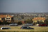 I-635 (foreground) passes by apartments and houses in Irving, extending as far as the eye can see. In a state where the counties hugging the western side of Interstate 35 divide the state's population, with 85 percent to the east and 15 percent to the west, the overwhelming majority lives within an easy commute of these interstate corridors.