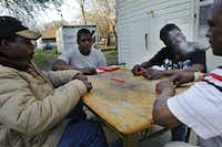 From left: Jerry Henderson, Ricky Hunter, Sandra Davis, and Danny Tutson play dominos in Kemp. Nearly 3.4 million of the state's 4.3 million population growth since 2000 occurred in the Houston/San Antonio/Dallas-Fort Worth triangle area and the racial and ethnic makeup is about the same as for the state as a whole.