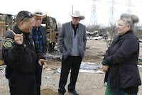 Garcia talks with (from left) James Robertson, Douglas Robertson and Lori Maxwell at the Plantation Place RV Park. Maxwell's RV was totaled in the tornado.(David Woo - Staff Photographer)