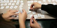 Kristy Corbeil (left), 17, and Natasha Houshmand, 15, work on a puzzle using Chinese characters as they practice sentence structure during their Mandarin class at the Westwood School.