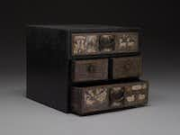 """In the """"Jerry Lee Musslewhite Collection of Korean Art"""" is a woman's incidental box made of wood with black lacquer and  mother-of-pearl inlay and yellow brass and copper fittings."""