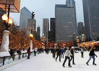 Ice skating in downtown Chicago in front of the Cloud Gate Sculpture and with the city skyline as backdrop is always a popular holiday activity for kids of all ages.