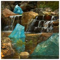 Chihuly's Blue Polyvitro Crystals are seen in a stream at the Dallas Arboretum. Photographed with a Canon 5D Mark III.Tom Fox