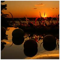 Chihuly's Carnival Boat is seen at sunset, at the Dallas Arboretum. Photographed with a Canon 5D Mark III.Tom Fox