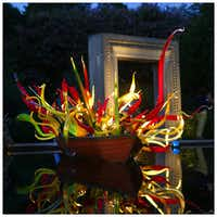 Chihuly's Carnival Boat is seen at dusk, at the Dallas Arboretum. Photographed with a Canon 5D Mark III.Tom Fox