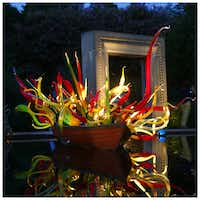Chihuly's Carnival Boat is seen at dusk, at the Dallas Arboretum. Photographed with a Canon 5D Mark III.(Tom Fox)